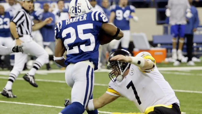 The tackle that saved a Super Bowl: Pittsburgh QB Ben Roethlisberger swipes at the injured knee of Colts cornerback Nick Harper in the 2005 NFL Playoffs.