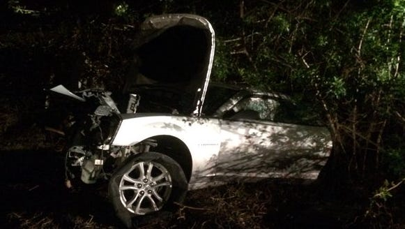 The silver unoccupied vehicle struck by a train on Monday, Oct. 26, 2015.