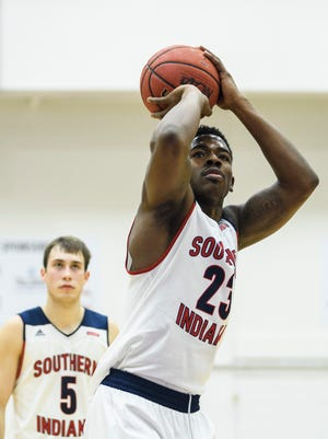 USI's DayJar Dickson (23) attempts a free-throw as his team takes on the Ohio Valley Fighting Scots in Evansville, Ind., Sunday, Dec. 31, 2017. The Screaming Eagles defeated the Fighting Scots, 95-69, in their last non-conference game of the season.