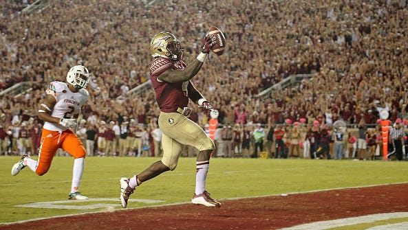 Florida State's Dalvin Cook Dalvin (4) rushes for a touchdown against Miami last season.