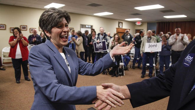 Joni Ernst, Republican candidate for U.S. Senate, shakes hands with a supporter <137>Iowa congressmen Dan Zumbach <137>at the start of a campaign event Oct. 13 <137>, Oct. 13, 2014 <137>in Monticello. The visit was one of six stops she had scheduled for the day.