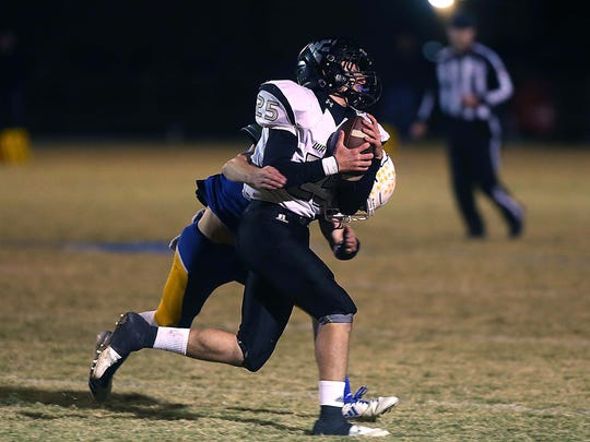 Water Valley's Gunnar McCoy is tackled by a Veribest defender during their game Nov. 10, 2017.