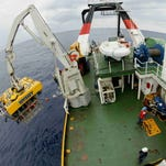 In 2003 the Odyssey Marine Exploration's eight-ton remotely operated vehicle, named Zeus, is launched for a descent to the ocean floor from the ship Odyssey Explorer about 100 miles off the coast of Georgia.