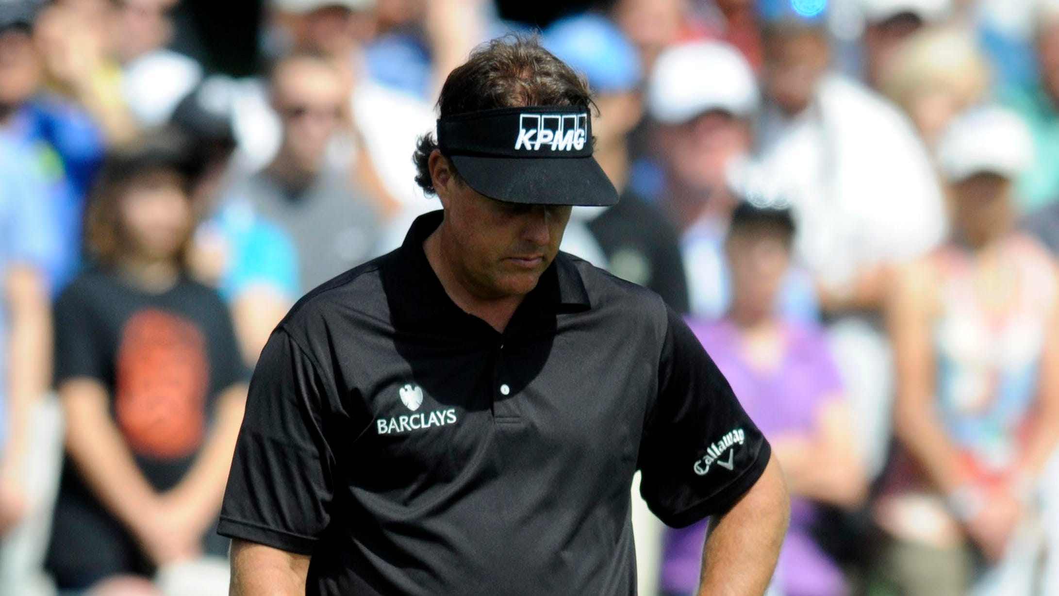 Phil Mickelson waits to putt on the 5th green.