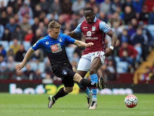 Aston Villa's Aly Cissokho, right, and AFC Bournemouth's Matt Ritchie battle for the ball during their English Premier League soccer match at Villa Park, Birmingham, England, Saturday, April 9, 2016. (Clint Hughes/PA via AP) UNITED KINGDOM OUT