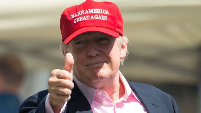 President Trump gives a thumbs-up well wishers as he arrives at the 72nd US Women's Open Golf Championship at Trump National Golf Course in Bedminster, N.J., July 16, 2017.