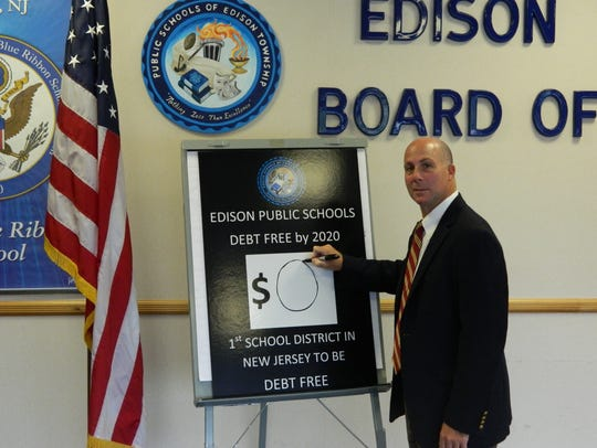 Superintendent of Schools Richard O'Malley shows  Edison