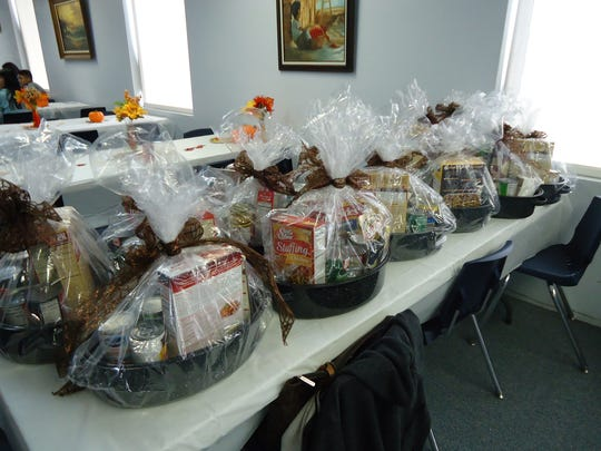 The Assisteens put together 12 Thanksgiving dinner baskets.