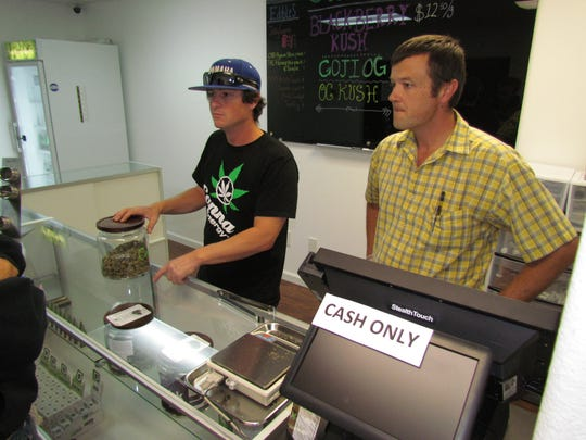 Adam Culbertson, left, and Cleve Stanley opened Home Grown Remedies in downtown Stayton on Thursday, Oct. 1, the first day Oregon law allowed for retail recreational marijuana sales at dispensaries. The Stayton entrepreneurs received business from all up and down the east side of the Mid-Willamette Valley.
