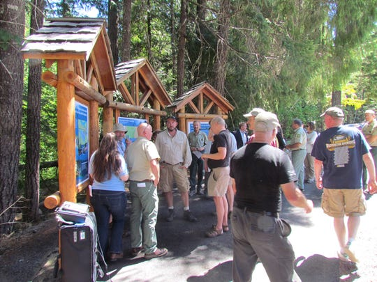 Several dozen people of various walks turned out to celebrate the dedication of Marion Forks day-use area. Improvements to fish hatchery grounds site include environmentally aesthetic informational kiosks, railings and picnic areas along with riparian restoration and relocated campgrounds and rest-stop facilities.