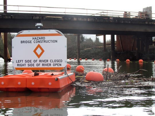 Kayaking through Willamette Slough takes you under the Peter Courtney Minto Island Bridge, which is under construction.