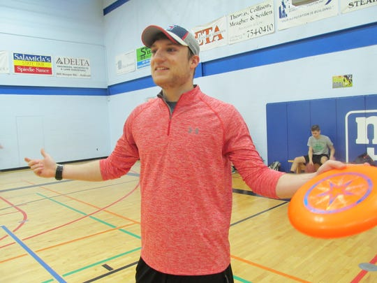 Jake Pine runs Frisbee clinics and mentors teenagers for the OASIS After-School program.