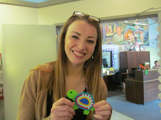 Theresa Askew shows off a decoration given to her by