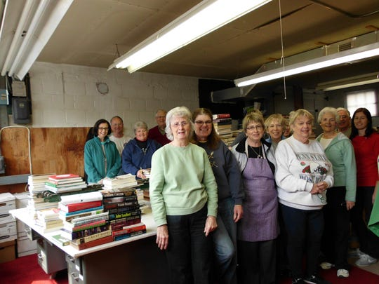 Pictured is one of the work groups responsible for putting together the enormous Friends of Legal Services Book Sale, coming up May 6-8.