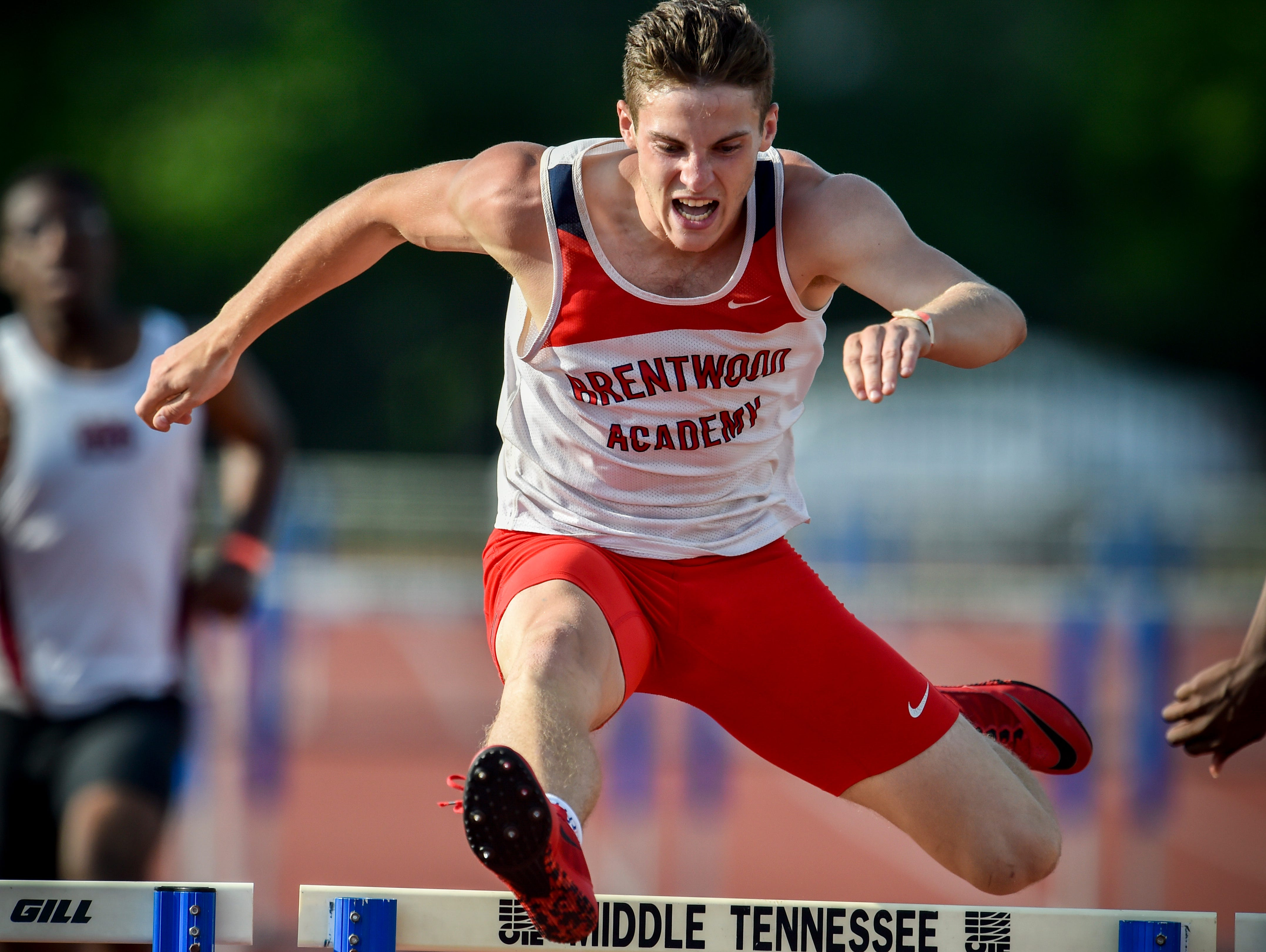 Brentwood Academy's George Patrick competes in the D-II 300m hurdles during the Spring Fling boys state track meet at MTSU's Dean Hayes Track and Field Stadium, Friday, May 27, 2016, in Murfreesboro, Tenn. Patrick finished in first place.