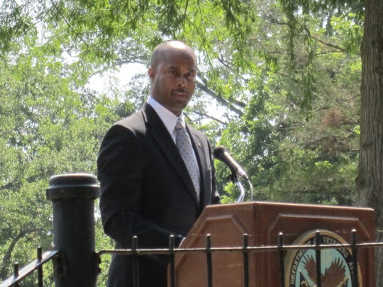 Peter C. Dancy Jr., the medical center director of the Alexandria VA Health Care System and an Army veteran, speaks on Monday during the Memorial Day ceremony at the Alexandria National Cemetery.