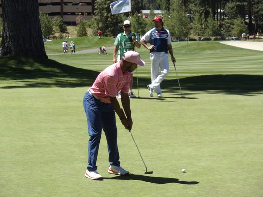 Lions wide receiver Golden Tate putts at the American Century Championship at Lake Tahoe.