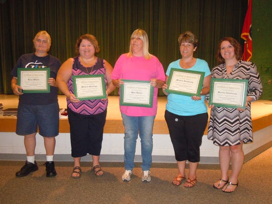 From left are 10-year service award recipients Lisa