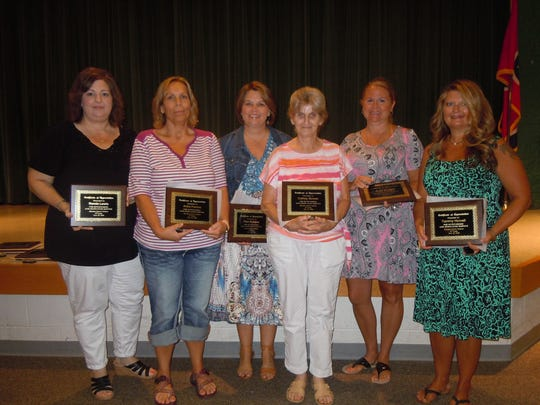 Fifteen-year service award recipients are, from left,