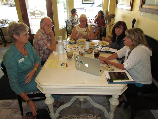 Left to right around the near table, Kelly Schreiber, Paul Toews, Rese Bourdeau, Dani Brazelton and Cherie Clark during Canyon Conversations Sept. 14 at Moxieberry in downtown Stayton.