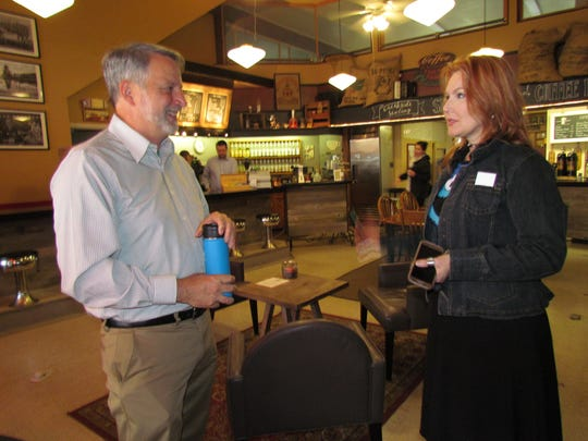 House District 18 candidate Tom Kane and local artist Lori Lee McLaughlin of White Oak Gallery during the Creekside Chat at Silver Creek Coffee House.