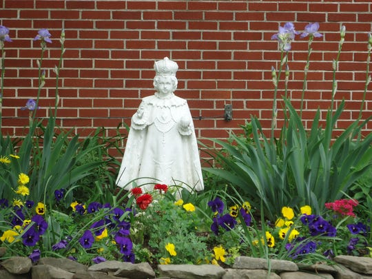 Summer flowers surround the Infant of Prague at St. Rose of Lima in Haddon Township.