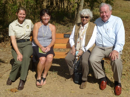 Manager of Seven Islands State Birding Park Justine Cucchiara, executive director of Legacy Parks Foundation Carol Evans, with Linda and Pete Claussen for the bench dedication celebration.