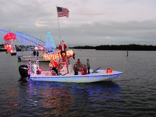 In the staging area just prior to the parade is Team Spriggy, captained by Steve Sprigg who won the Dynamic Design Award in Capri's 2015 Annual Christmas Boat Parade.  The Sprigg's three-month old baby girl Ruby was their youngest crew member.