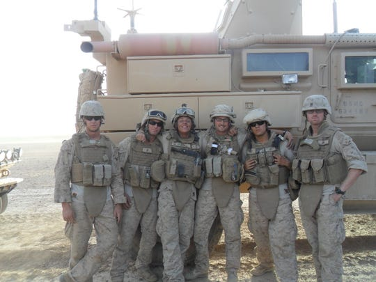 A group of Marines, nicknamed the cowboys from hell, pose while en route to deliver supplies to a forward operating base in Afghanistan. Brian Moore, a Lafayette resident, is on the far right. Keaton Mahan, one of the cowboys, is making a documentary about their experiences.
