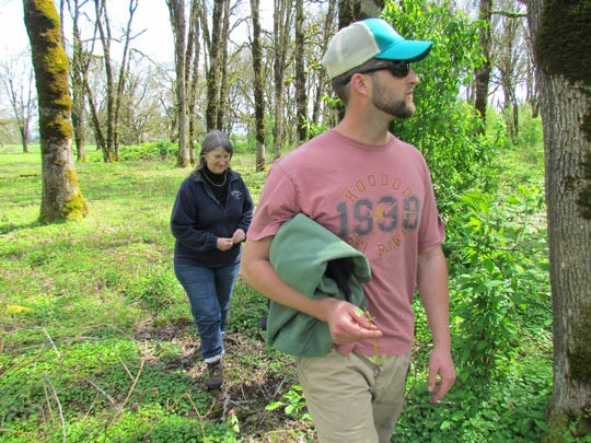 Luke Fitzpatrick and his mom Kathy Bridges survey 80 acres of Oregon white oak savanna ? a regionally rare habitat type in the Willamette Valley that's stands to be in  their custody at Santiam Valley Ranch.