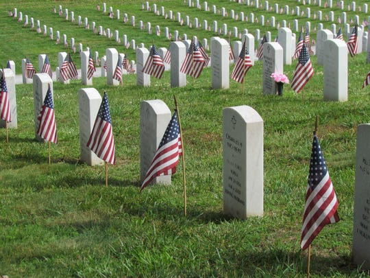 Headstones at the Tennessee Veterans Cemetery at 5901 Lyons View Pike are marked with American flags on a previous Memorial Day.