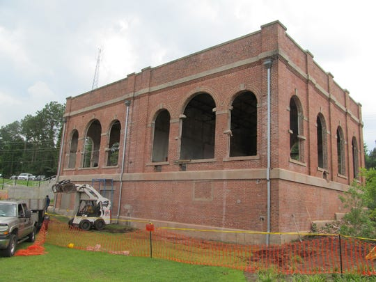 In summer 2014, workers were renovating the former City of Tallahassee electric building in Cascades Park, which is scheduled to become the home of Edison's bar and grill.