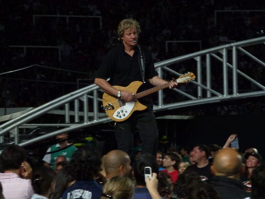 Dallas Schoo handles soundcheck at a U2 gig, with one of his trademark blue picks ready to go.