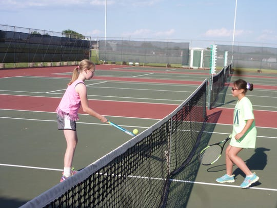 Faith Brown (left) and Emily Blake compete at the local