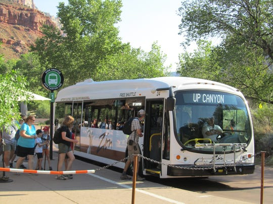 A Proterra electric bus operates at Zion National Park, part of a pilot program to see if electric vehicles could be used as the main shuttle fleet at the park.