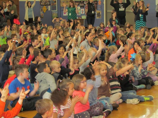 Cheering on the coach. Stayton Elementary School students raised more than $7k for the American Heart Association through Jump Rope for Heart, prompting their PE teacher Chuck Larimer to get a colorful mohawk.