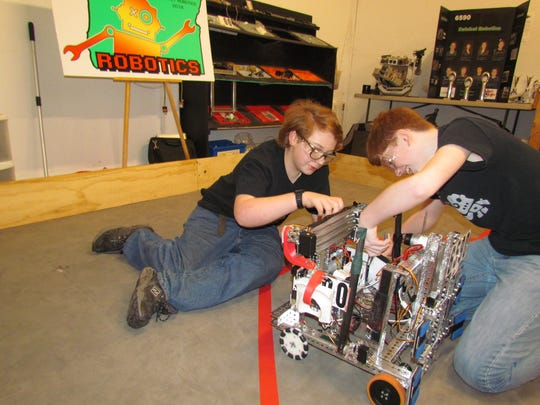 Ben Sawyer and Reese Cureton work on the Robot. Ratchet