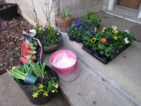 Gathering plants, potting mix and other supplies makes