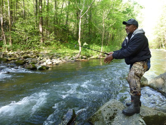 Charles Moulden fishes for trout in the Tellico River