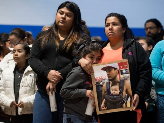 Esmeralda Baustista holds a photograph of her brother Luis Bautista-Martinez, who was one of the workers detained when ICE raided Southeastern Provisions, a cattle slaughterhouse in Grainger County. With Bautista is daughter Yemaya and friend Yaqueline Cruz. The three attended a prayer vigil on Monday, April 9, 2018 at Hillcrest Elementary School in Morristown, TN held in response to the raid.