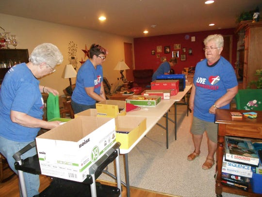 Women of St. Andrew and other ELCAs assembling kits for Lutheran World Relief.