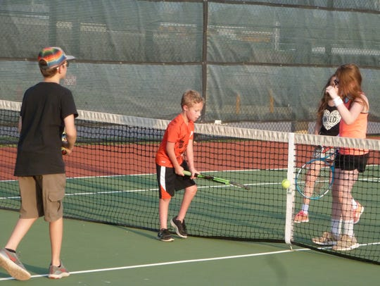 Hunter White, Bodie Brookshire, Reagan Hicks and Bailee Burnett (from left to right) compete in a game of roll ball at the 27th annual Neighborhood Tennis Program that was sponsored by the Wichita Falls Tennis Association.
