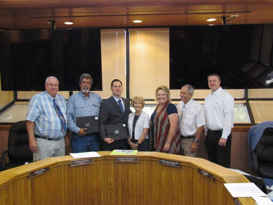 Pictured from left to right are Commissioner Larry