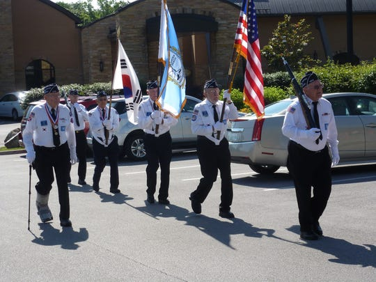 Gene A. Stone (left) and a group of veterans from the Crossville chapter of Korean War Veterans Association.
