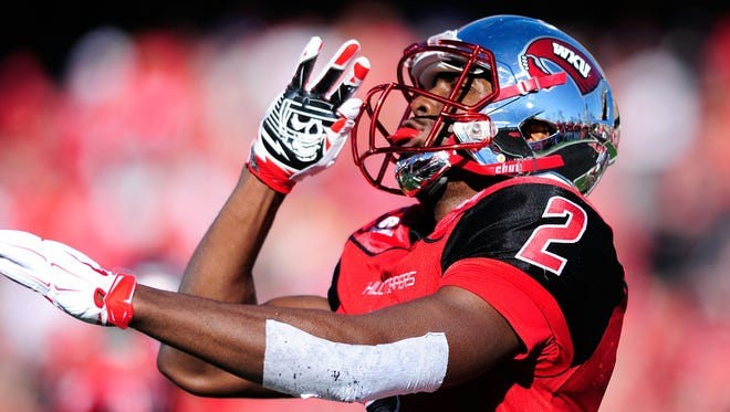 Dec 5, 2015; Bowling Green, KY, USA; Western Kentucky Hilltoppers wide receiver Taywan Taylor (2) celebrates after scoring a touchdown during the first half of the Conference USA football championship game against Southern Miss Golden Eagles at Houchens Industries-L.T. Smith Stadium. Mandatory Credit: Joshua Lindsey-USA TODAY Sports