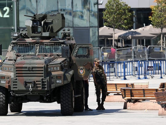 Turkish policemen with heavy weapons secure the area