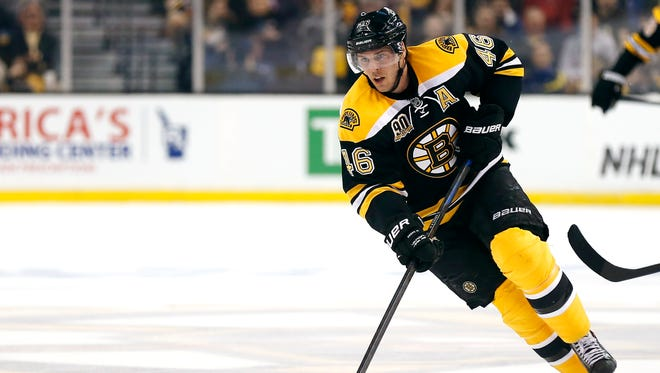 Boston Bruins' David Krejci skates against the Detroit Red Wings during the second period of a first-round NHL playoff hockey game in Boston Friday, April 18, 2014.