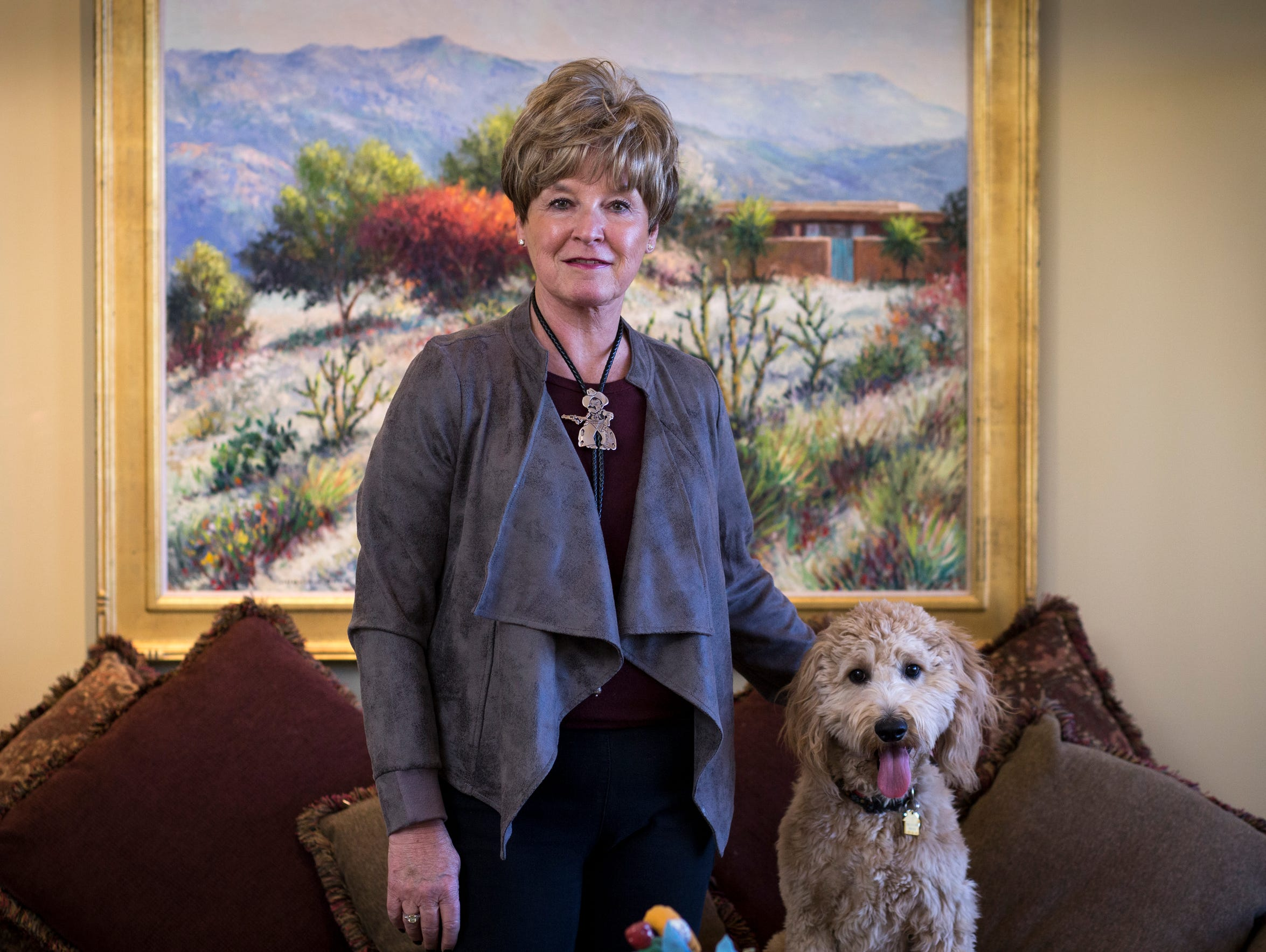 MaryLou Davis, and her dog, Winnie, at their home in