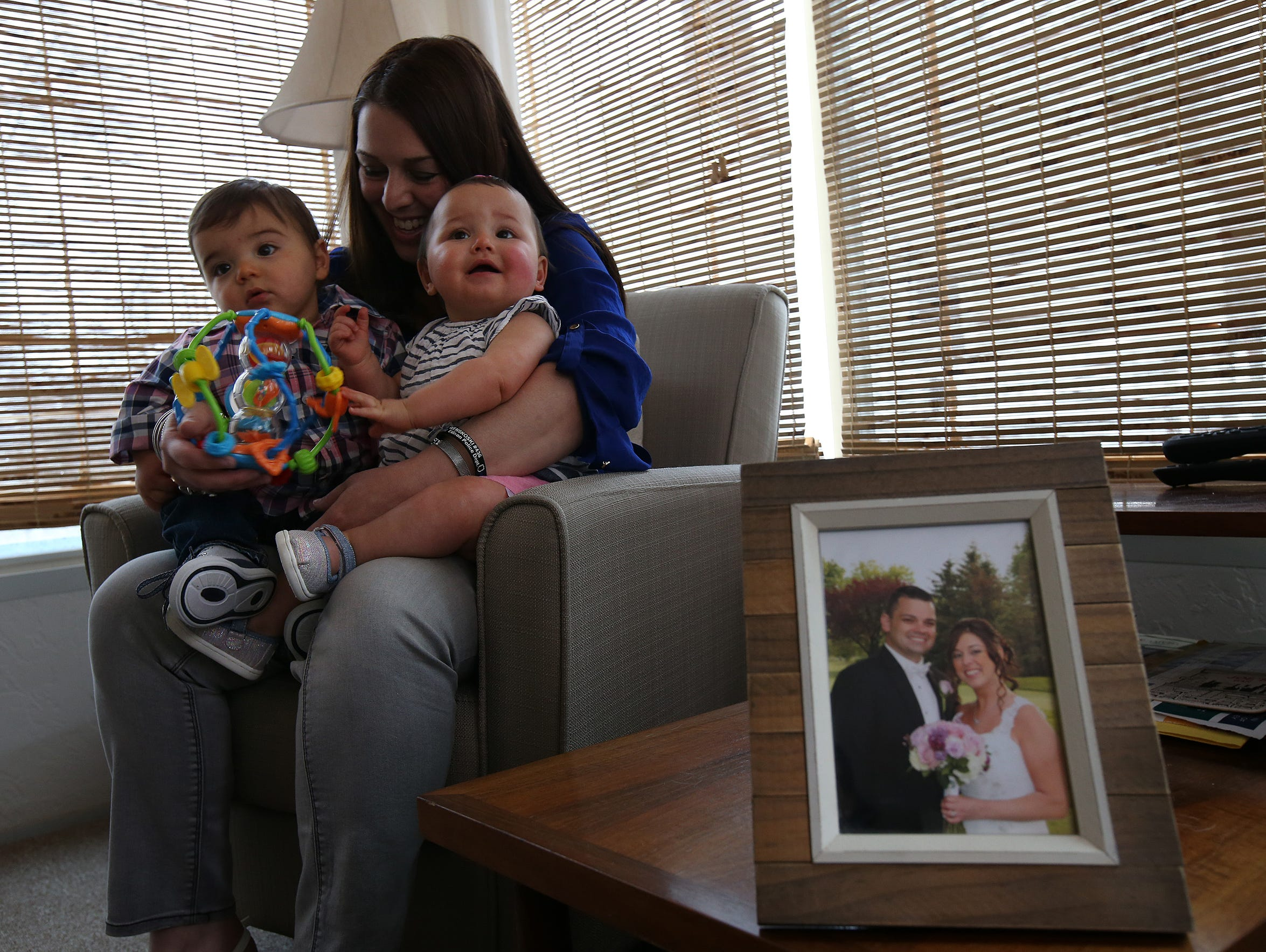 Tracy Wenskoski holds her 10-month-old twins, Joseph and Isabella, at their home in North Plainfield.
