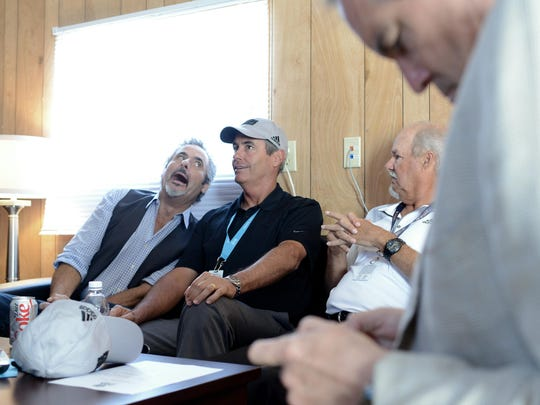 CBS Sports personality David Feherty jokingly makes a face next to colleague Ian Baker-Finch as they interview at the CBS compound at Whistling Straits.